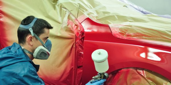 painting a car.